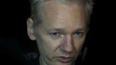 WikiLeaks founder Julian Assange speaks to the press  as he arrives at Ellingham Hall in Ellingham, Norfolk, the home of friend   Vaughan Smith.
