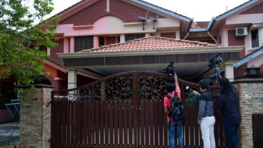 Kuala Lumpur: Members of the international press attempt to get someone to speak to them in front of the house of Fariq Abdul Hamid,