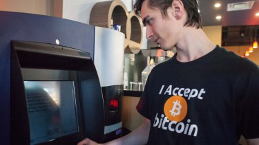 Gabriel Scheare uses what is claimed to be the world's first bitcoin ATM at Waves Coffee House in Vancouver, Canada.