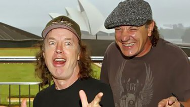 Rock on … Angus Young and Brian Johnson at The Rocks in Sydney yesterday.
