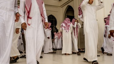 Men leave a mosque after prayers in Riyadh, in ultraconservative Saudi Arabia.