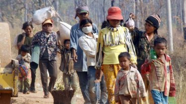 Caught in the crossfire ... Cambodian villagers flee their homes.