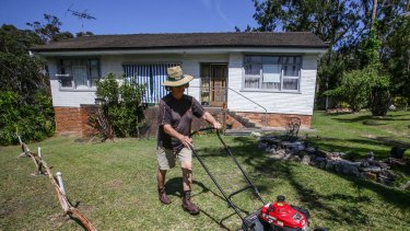 David Blakey, who mows lawns for a living, at a property on Sydney's Northern Beaches.