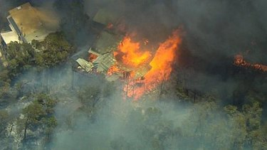 Homes were destroyed by bushfire in Roleystone.