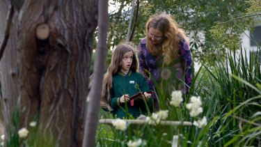Zoe McIver, 11,  and her mother Linda record bird data on the ClimateWatch app.