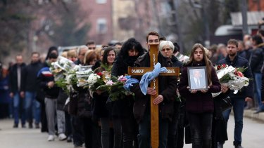 People follow the casket during a final farewell of Kosovo Serb politician Oliver Ivanovic.