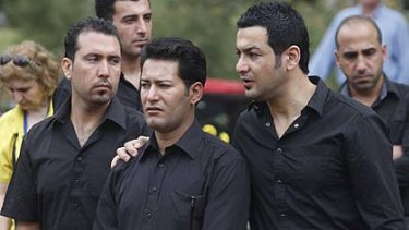 Madian el-Ibrahimy (centre), who lost his wife, son and daughter in the Christmas Island boat tragedy.