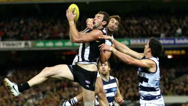 Travis Cloke marks strongly despite the full fist from Corey Enright during Collingwood's round 19 win.