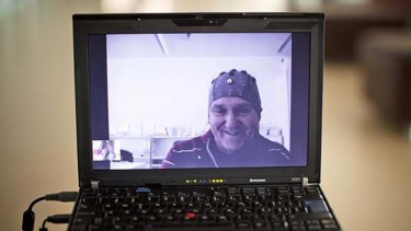 Mark-Andre Duc, a partially tetraplegic patient, is seen on a laptop as he talks to scientists in Switzerland's Federal Institute of Technology in Lausanne, from a hospital 100 kilometers away.