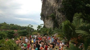 Tourists evacuate to higher ground at Krabi in Thailand in this picture, posted on Twitter.