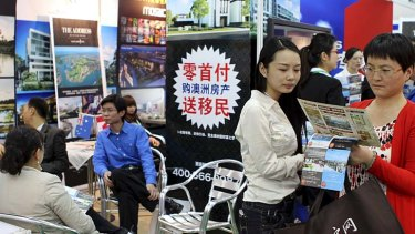 Impact overstated: Investors crowd around an Australian real estate booth at a property fair in Beijing.