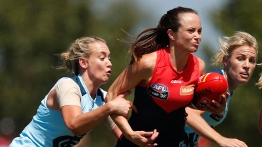 Daisy Pearce, seen here being tackled by Lauren Arnell, has been inspirational for the Demons.
