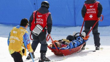 Jacqueline Hernandez of the US is carried off the track on a stretcher after crashing during the women's snowboard cross qualifier.