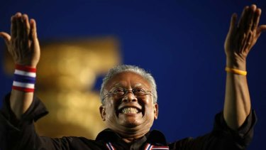 Street fighting man: Suthep Thaugsuban acknowledges the crowd at a protest this week in central Bangkok.
