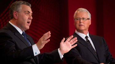 """""""We didn't say we wouldn't raise any taxes"""": Joe Hockey addresses a live forum at Penrith Panthers Leagues Club for the ABC's <em>Q&A</em> with host Tony Jones, right."""