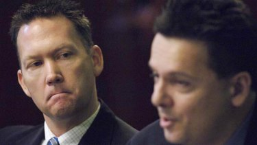 Dennis Hood (from Family first) looks on at Nick Xenophon during debate of the upper house candidates at Old Parliament House Adelaide in 2006.
