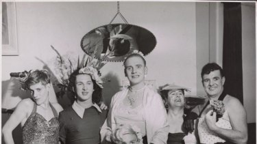 Birds of a feather: Cross-dressing men strike a pose at a house party in the 1950s.