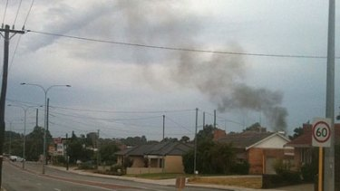 Smoke rises into the air after the Yokine power substation was struck by lightning.