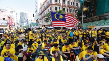 Protesters occupy a street in downtown Kuala Lumpur to demand electoral reform and Najib Razak's resignation.
