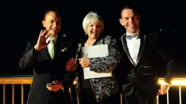 ACT celebrant Sharyn Gunn, centre, officiates over Australia's first Australian legal same sex marriage between Alan Wright  (left) and Joel Player.