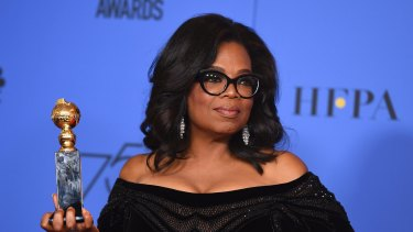 Oprah Winfrey poses with the Cecil B. DeMille Award at the 75th annual Golden Globe Awards.