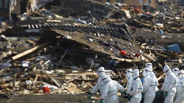 Japanese police officers during a search and recovery operation for missing victims in the area devastated by the March earthquake and tsunami in Namie, Fukushima.