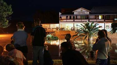 Local entertainment ... residents watch the Clarence River rise in Grafton.