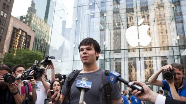 Evan Wiendczak mobbed by the media after buying the first iPhone 4 at the Apple store on Fifth Avenue in New York.