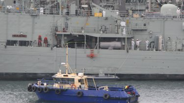 Shark attack ... the person was reportedly attacked near HMAS Darwin  in Woolloomooloo Bay.