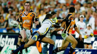 Passing as a great ...Tigers superstar Benji Marshall sets up one of the most memorable grand final tries of all time when he flick passes to Pat Richards against the Cowboys.