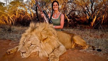 Hardcore huntress: The photograph of a smiling Melissa Bachman and the slain lion that has outraged people around the world.