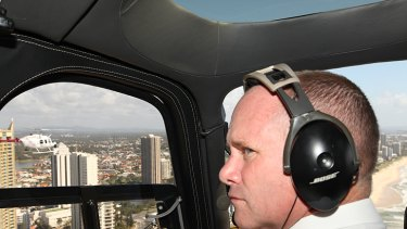 Campbell Newman in a helicopter over the Gold Coast this morning.