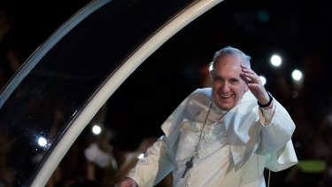 Pope Francis waves to the faithful upon his arrival in the Philippines on Thursday.