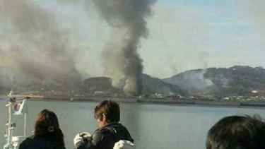 Smoke is seen at Yeonpyeong island near the border against North Korea, in South Korea.