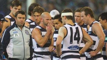 Cat chat: Geelong coach Chris Scott (left) prepares to speak to his team on Saturday night.