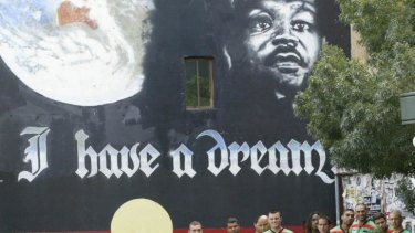 Band of brothers: Souths' indigenous contingent, led by David Peachey, third from right, in front of the inspirational mural in Newtown in 2007.