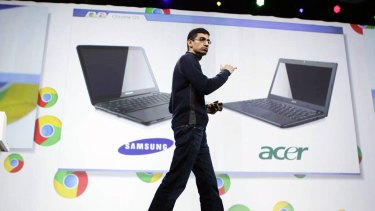 Sundar Pichai, VP of Product Management for Google, displays Acer and Samsung notebooks running on the Chrome operating system at the Google IO Developers Conference in San Francisco.