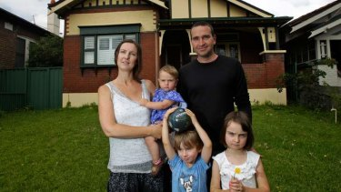 Shame: Liz and Joe Slakey with their children, Luca, 6, Declan, 4 and Pip, 1 at their Haberfield home.