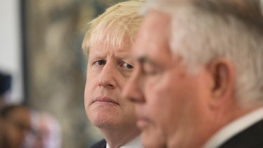 US Secretary of State Rex Tillerson, right,   with British Foreign Secretary Boris Johnson in London on Monday. Mr Tillerson said that he saw progress in getting European support for tough new penalties against Iran that could prevent a US withdrawal from the Iran nuclear deal.