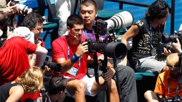 He's finally snapped ... Serbia's Novak Djokovic steps behind the lens at the Rally for Relief event.