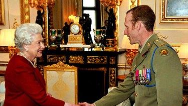 Victoria Cross recipient Mark Donaldson meets the Queen at Windsor Castle.
