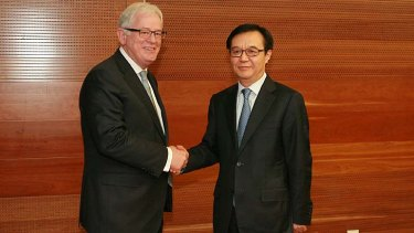 """""""We feel we've got a way through"""": Andrew Robb with China's Commerce Minister Gao Hucheng."""