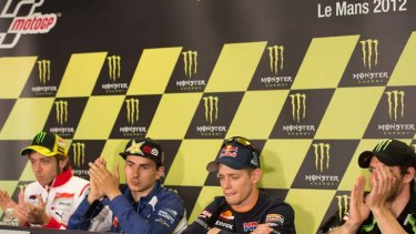 The MotoGP riders applaud Casey Stoner of Australia and Repsol Honda Team after the announcement of his retirement at the end of this season.