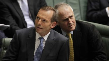 Opposition Leader Tony Abbott and Coalition communications minister Malcolm Turnbull. A new poll shows the Coalition would win the election in a landslide with Mr Turnbull as leader.