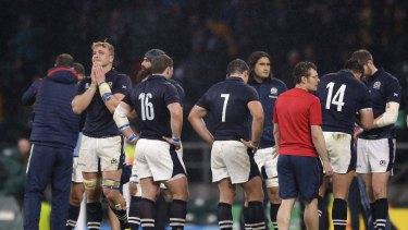 Heartbreak: Scotland react after Bernard Foley's last-gasp penalty.