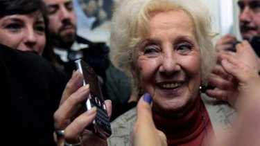 Carlotto, the president of an association that seeks to reunite babies stolen during the military regime with their biological parents or relatives, smiles after announcing the recovery of her grandson Guido.