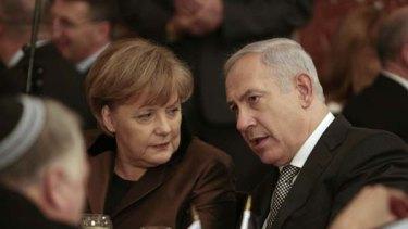 Benjamin Netanyahu sits next to German Chancellor Angela Merkel during a dinner in Jerusalem last week.