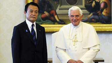 Close the gap... Pope Bennedict with Japan's Prime Minister Taro Aso.