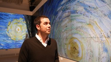 """Laurent Gaveau, director of """"Le Lab"""", with an enlarged section of Van Gogh's <i>Starry Night</i>."""