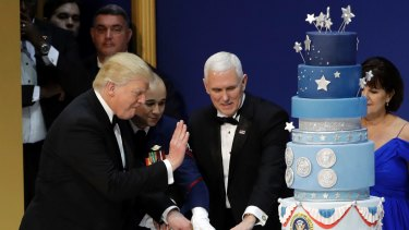 President Donald Trump and Vice-President Mike Pence cut the cake.